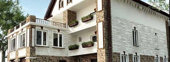 Фасады домов: штукатурка, кирпич или камень?